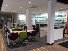 Young eye cancer survivor unveils new premises for Oxford optician