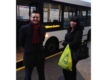 L-R: M&S Manager Nick Bluer with an M&S customer next to the free shuttle bus