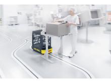 Skiftet til et dynamisk, automatiseret system med førerløse trucks sikrer virksomheden en tidsbesparelse på omkring 7.000 timer om året