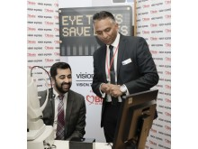 Humza Yousaf with Jay Ghadiali of Vision Express at OCT