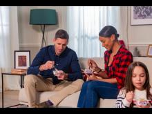 Family eating Müller Corner yogurts