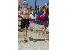 Discovery Surfers Challenge child reaches the finish line
