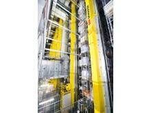 8 pallekraner lagrer pallerne i det 30 m. høje højlager - Vectura AS