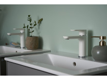 White (matte) Estetic taps on a gray Graphic bathroom cabinets.