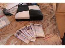 Bundles of cash found at the Knutsens' home