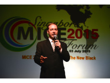 Mark Laudi emceeing at the Singapore MICE Forum 2015