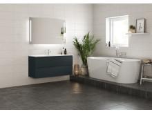 VikingBad MIE baderomsmøbel med nye farger. Avbildet mørk grå matt med ADA porselenservant. Badekar Ellipse med Tenge batteri og Frida hånddusj.