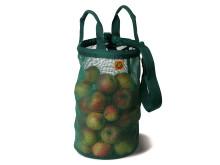 Skördeväska med äpplen