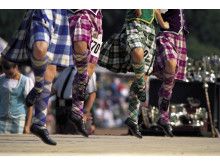 Ceilidh competition in Scotland with bright tartans ©VisitBritain