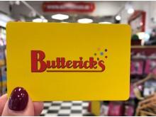 Gult presentkort från Butterick's