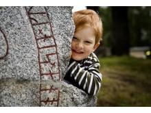 Sigtuna_Runic stone and child