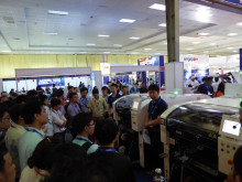 Visitors interested in actual operation and outputs at Panasonic's booth in NEPCON
