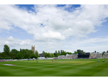 The RAF's Battle of Britain Memorial Flight Hurricane and Spitfire aircraft fly over Worcester's New Road cricket ground