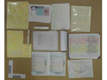 Blank passport pages recovered during the operation.