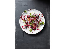 Beetroot with goat cheese and raspberries