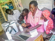 Nurse at Katoogo Health Centre III registers child for vaccination follow up.