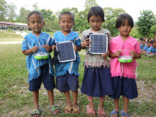 Students of Baan Soblan Primary School holding Panasonic solar lanterns
