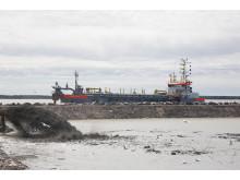 Imuruoppaaja Järviluodon läjitysaltaalla
