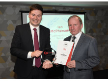 Martijn Gilbert (Managing Director)  presenting Ian McPherson with his award
