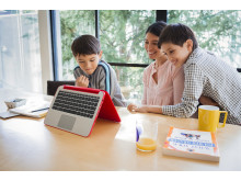 Mom and sons using the HP Pavilion x360 in the kitchen