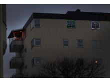 Julbelysning på balkong och fönster