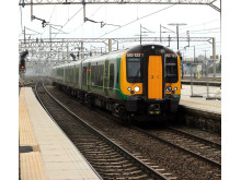 London Midland Class 350 travelling through Watford Junction station