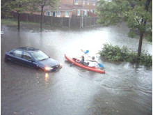 WATER SPORTS: Residents canoe down Wilton Grove in Heywood after flooding