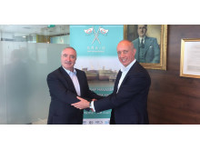 V.Group's Alasdair Evitt and Graig Shipping Plc's CEO, Hugh Williams shake hands