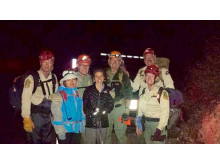 Hi-res image - ACR Electronics - hiker Yan Qu with their rescuers