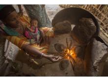 Traditionell eldstad skadar luften