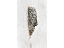 Granithovedet i Verninge Kirkes mur