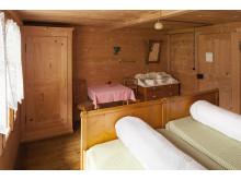 Uriges Zimmer im Hotel Waldrand Pochtenalp