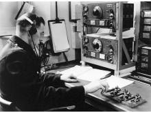 Radio Despatcher sends a message in Morse code