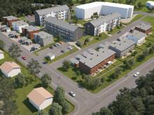 Översiktsillustration av det nya området, med BoKlok Sargen i förgrunden och lägenheter i tidigare byggd etapp i bakgrunden. Östersund.