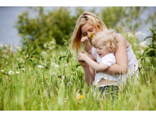 1930166-mother-and-son-in-grass-field