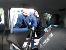 SAFETY FIRST: Casualty reduction officer Dave Godley showing how to check if a seat is secure