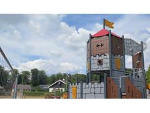 Klätterställning på lekplatsen i Falkvik på längre håll, CMYK