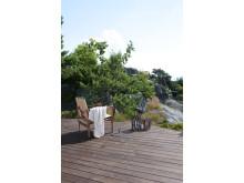 Fargesett terrassen din ut fra omgivelsene. TREBITT Terrassebeis i fargen 90000 Terrassebrun.