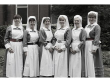Some of the senior nursing team in vintage uniforms