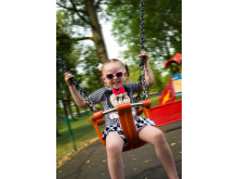FLYING HIGH: Abigail McMahon enjoys the swings at Truffet Park in Langley