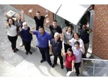 Glade rengøringsassistenter i en pause fra deres efteruddannelseskursus i Forenede Service