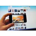 Biip-logo på iPhone-skjerm mot skjermbilde