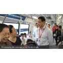 SMRT CEO Desmond Kuek interacting with commuters on the first day at work