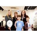 Young eye cancer survivor cuts ribbon to officially open refurbished Aylesbury optician