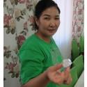 Kazakh lady holding a lump of sugar crystal (photo by schan)