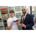 Courageous cancer survivor and Pride of Britain award-winner unveils restored Ruislip opticians following blaze