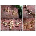 Förgyllda och skulpturalt utformade fasadskyltar platsmonterade för KI/ Karolinska Institutet