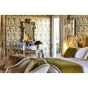 Känn historiens vingslag kring MGallerys mest spektakulära hotell