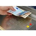 Skal du ta ut i norske kroner eller lokal valuta?