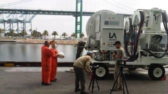 Mårten and Oskar discuss filming tactics beside a Cavotec AMP Mobile unit at the Port of LA #Cavotecfilm #shorepower